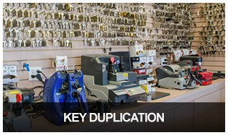 Image of a wall of key blanks and key cutters in the Keyway locksmith shop