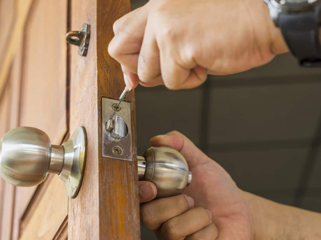 image of a locksmith replacing a lock set on a front door